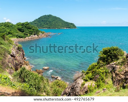 Beautiful seascape with mountain on blue sky. Coastline Scenery in Thailand.
