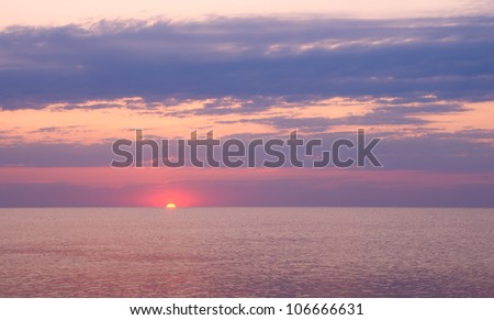 Beautiful seascape with orange warm sunrise, vacation concept - stock photo