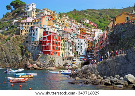 Beautiful seaside village in summertime, Riomaggiore, Cinque Terre National park, Ligurian region, Italy. - stock photo