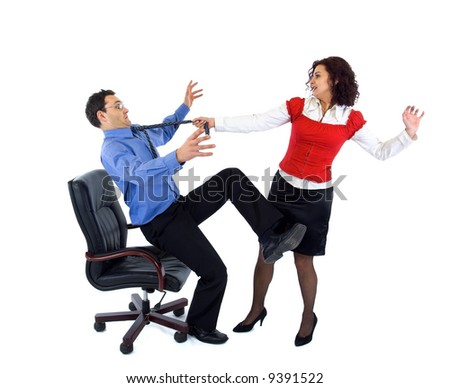 Beautiful secretary woman wresting businessman from armchair by tie