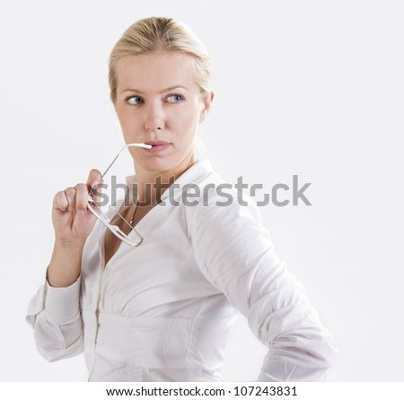 Beautiful seductive  business woman holding glasses - stock photo