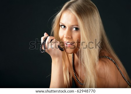 beautiful seductive woman with pearl necklace
