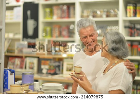 Beautiful senior couple in a shopping center