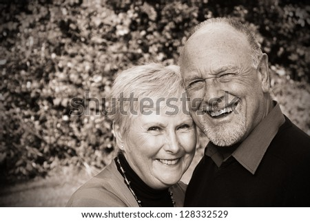 Beautiful senior couple (sepia) - stock photo