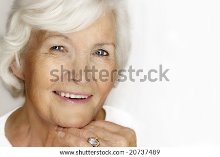 Beautiful senior lady laughing - stock photo