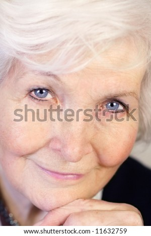 Beautiful senior woman face, closeup - stock photo