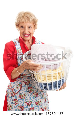 Beautiful senior woman in her apron, doing the laundry.  Isolated on white.
