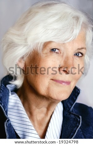 Beautiful senior woman portrait with fashion dress - stock photo