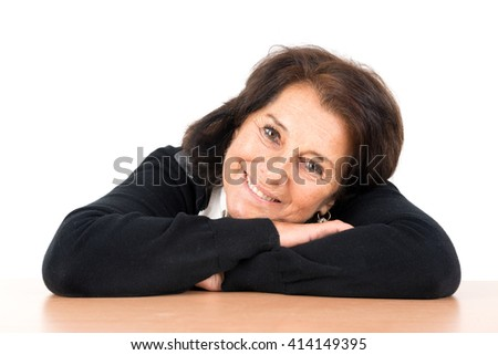 Beautiful senior woman posing isolated in a white background