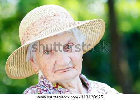 Beautiful senior woman relaxing in the nature - stock photo