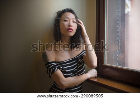 https://thumb7.shutterstock.com/display_pic_with_logo/620248/290089505/stock-photo-beautiful-sensual-asian-woman-posing-looking-seductive-at-camera-touching-hair-with-window-daylight-290089505.jpg