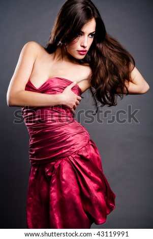 beautiful sensual brunette in elegant dress, studio shot - stock photo