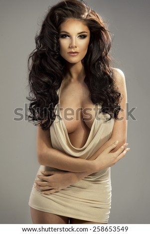 beautiful sensual brunette woman with long curly hair - stock photo