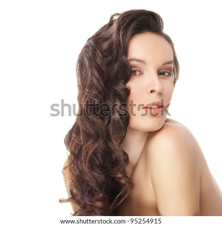 Beautiful sensual brunette woman with long wavy hairs - isolated on white