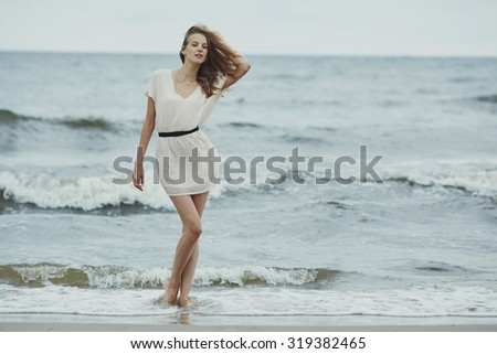 beautiful sensual girl in cold water portrait