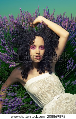 Beautiful sensual lady lying in fairy lavender flowers - stock photo