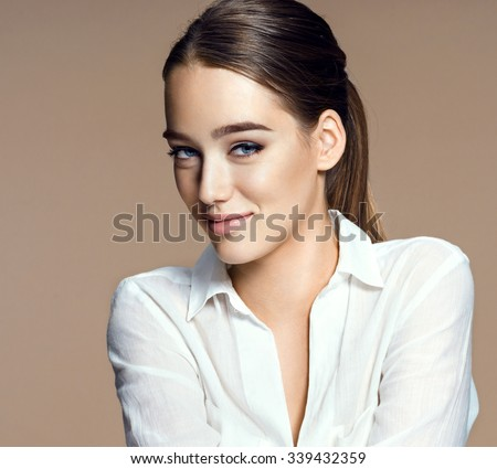 Beautiful sensual woman face, skin care concept / photo-composition of brunette girl on beige background - stock photo