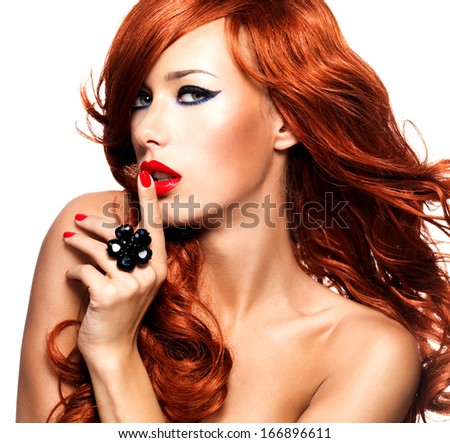 Beautiful sensual woman with long red hairs and red nails -  isolated on white. - stock photo