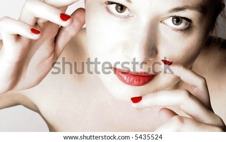 Beautiful sensual woman with red lips and nails.
