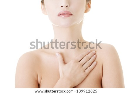 Beautiful sensual young woman touching her chest, isolated on white