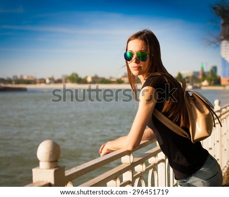 beautiful sensuality elegance haired hair woman happy fun cheerful smiling blue sunglasses black t-shirt urban city portrait nature slim sport body space impressions megalopolis autumn sunny - stock photo