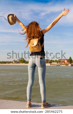 beautiful sensuality elegance lady haired hair woman happy fun back black t-shirt jeans urban city portrait nature slim sport body river blue sky river water ass - stock photo