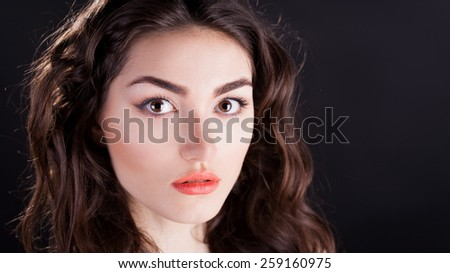 beautiful sensuality elegance lady woman serious face with brown eyes, studio portrait and professional light, nature romantic wellness pure makeup, gloss on the hair brunette, black background - stock photo