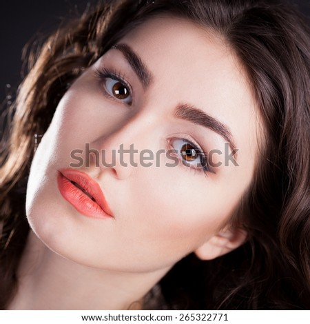 beautiful sensuality elegance lady woman serious face with brown eyes studio portrait professional light nature romantic wellness pure gloss hair brunette black background - stock photo