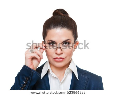 Beautiful, serious  businesswoman  wearing glasses and a formal office suit, looking at camera.