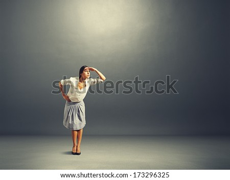 beautiful serious woman attentively peered at something   - stock photo