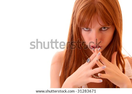 Beautiful serious woman with crossed fingers isolated on white - stock photo