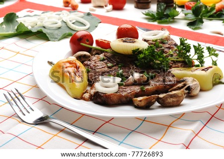 Beautiful served food on plate, meat with natural vegetables ingredients - stock photo