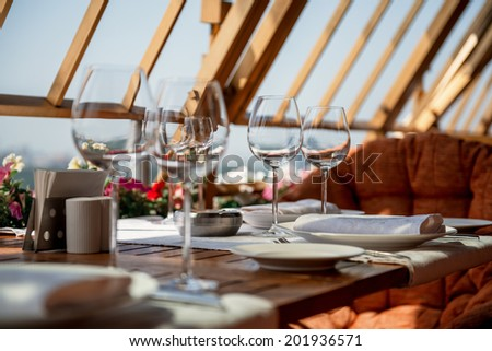 Beautiful served table on balcony in luxury restaurant - stock photo