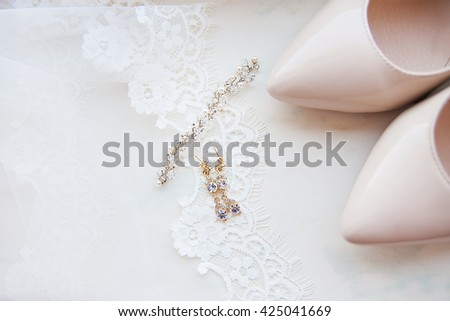 Beautiful set of women's wedding accessories. Bride's morning. White shoes.