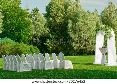 Beautiful setting for outdoors wedding ceremony waiting for bride and groom and guests - stock photo