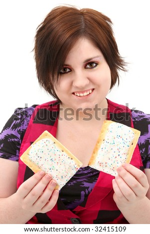 Beautiful seventeen year old teen girl holding two toaster pastries.