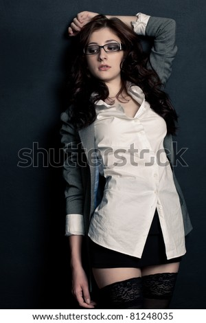 beautiful sexual businesswoman near wall wearing stockings - stock photo