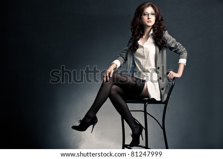beautiful sexual businesswoman sitting on chair