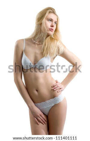 Beautiful sexual girl blonde in linen pose on white background, is insulated
