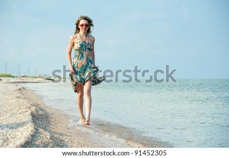 Beautiful sexual girl blonde pose on beach - stock photo
