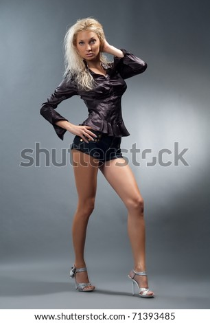 Beautiful sexual girl blonde pose on gray background
