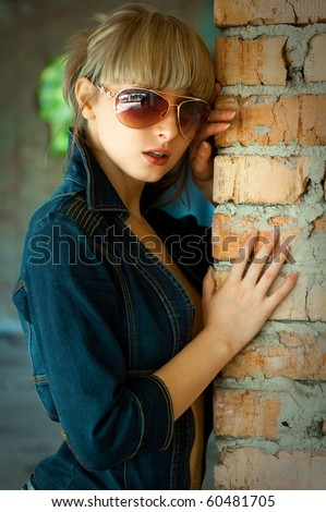 Beautiful sexual girl model pose beside old brick wall