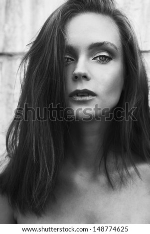 beautiful sexual portrait of young caucasian woman with amazing eyes