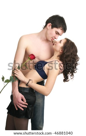 Beautiful sexual semi-dressed couple isolated over white background - stock photo