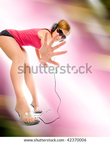 beautiful sexual woman in headphones - stock photo