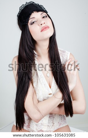 beautiful sexual young woman dressed in white underwear with a bandage for sleeping. She poses in the studio on a white background - stock photo