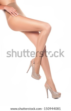 Beautiful sexy and long woman legs, on a white isolated background - stock photo