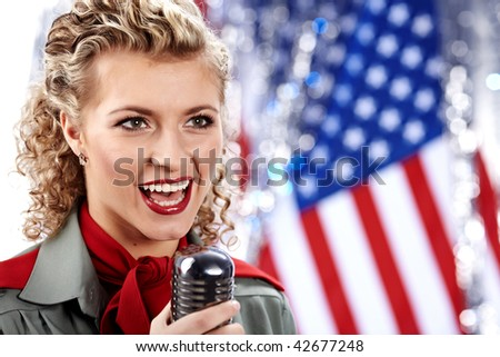 Beautiful sexy army woman singing - stock photo