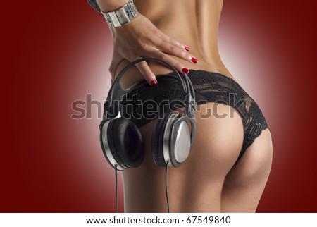 Beautiful sexy ass with dj headphones - stock photo