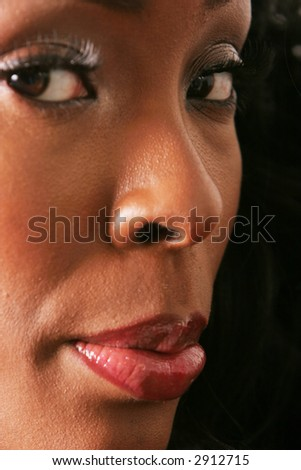 Beautiful sexy black woman face - stock photo